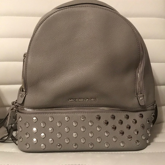 688585d0ee1e5 Michael Kors Rhea medium studded leather backpack.  M 5a8b8c87077b9776a8e03edc